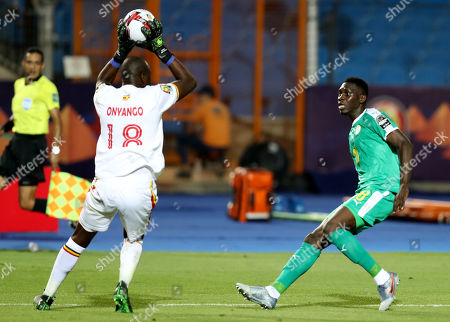 Denis Onyango (L) of Uganda challenged by Ismaila Sarr of Senegal during the 2019 Africa Cup of Nations (AFCON 2019) round of 16 soccer match between Uganda and Senegal in Cairo Stadium in Cairo, Egypt, 05 July 2019.