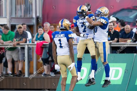 Winnipeg Blue Bombers wide receiver Nic Demski (10) celebrates after his touchdown with Lucky Whitehead (7) and Darvin Adams (1) during the Canadian Football League game between the Winnipeg Blue Bombers and Ottawa Redblacks at TD Place Stadium in Ottawa, Canada Daniel Lea/CSM