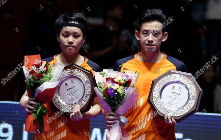 Winner Doo Hoi Kem (L) and Wong Chu Ting (R) of Hong Kong holds up their trophies during the award ceremony for the mixed doubles table tennis category at the Seamaster 2019 International Table Tennis Federation (ITTF) World Tour Shinhan Korea Open in Busan, South Korea, 06 July 2019.