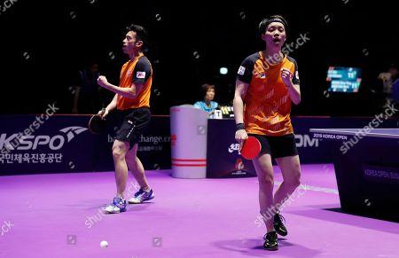 Wong Chu Ting (L) and Doo Hoi Kem (R) of Hong Kong in action against Xu Xin and Liu Shiwen of China during the mixed doubles table tennis finals at the Seamaster 2019 International Table Tennis Federation (ITTF) World Tour Shinhan Korea Open in Busan, South Korea, 06 July 2019.