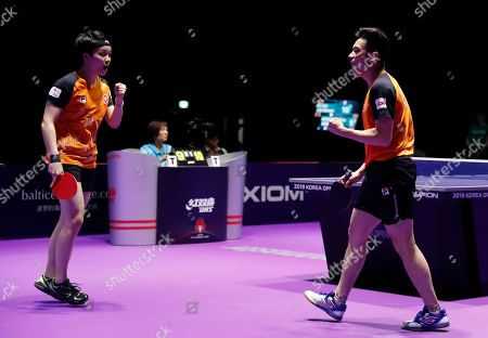 Wong Chu Ting (R) and Doo Hoi Kem (L) of Hong Kong in action against Xu Xin and Liu Shiwen of China during the mixed doubles table tennis finals at the Seamaster 2019 International Table Tennis Federation (ITTF) World Tour Shinhan Korea Open in Busan, South Korea, 06 July 2019.