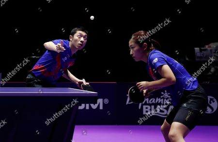 Liu Shiwen (R) and Xu Xin (L) of China in action during the mixed doubles table tennis finals match against Doo Hoi Kem and Wong Chu Ting of Hong Kong during the mixed doubles table tennis finals at the Seamaster 2019 International Table Tennis Federation (ITTF) World Tour Shinhan Korea Open in Busan, South Korea, 06 July 2019.