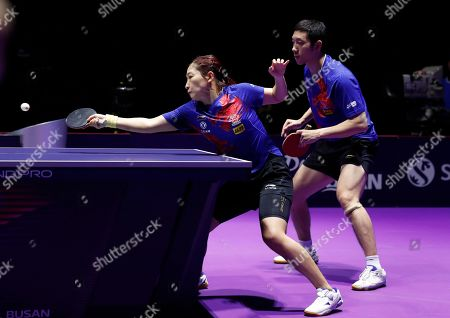 Liu Shiwen (L) and Xu Xin (R) of China in action during the mixed doubles table tennis finals match against Doo Hoi Kem and Wong Chu Ting of Hong Kong during the mixed doubles table tennis finals at the Seamaster 2019 International Table Tennis Federation (ITTF) World Tour Shinhan Korea Open in Busan, South Korea, 06 July 2019.