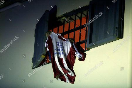 Inmates of La Esperanza prison wave a Paraguay national soccer team jersey out of a window after fellow inmate and boxer Richard Moray defeated Brazil's Carlos Santos de Jesus in the super-welter weight South American title fight in Asuncion, Paraguay, . Moray won by knock-out in the first round