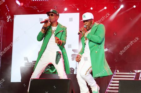 Ronnie Devoe, Michael Bivins. Ronnie Devoe and Michael Bivins perform at the 2019 Essence Festival at the Mercedes-Benz Superdome, in New Orleans