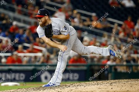 Kansas City Royals relief pitcher Ian Kennedy throws to the Washington Nationals during a baseball game, in Washington