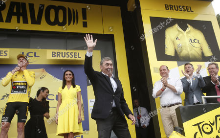 Belgian cycling legend Eddy Merckx (C) reacts on the podium following the 1st stage of the 106th edition of the Tour de France cycling race over 194.5km around Brussels, Belgium, 06 July 2019.