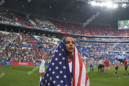 Kelley O Hara with the United States flag