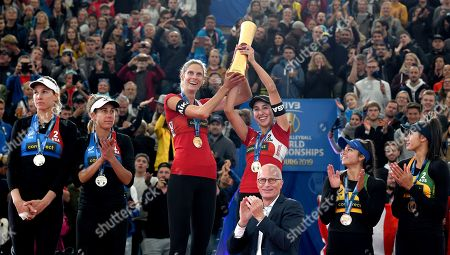(L-R) USA's Alix Klineman and April Ross (Silver Medal), Canada's Sarah Pavan and Melissa Humana-Paredes (Gold Medal) and Australia's Mariafe Artacho and Taliqua Clancy (Bronze Medal) on the podium during the Beach Volleyball World Championships match in Hamburg, Germany, 06 July 2019.