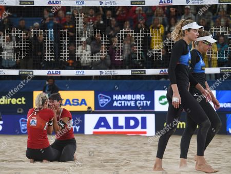 xCanada's Sarah Pavan and Melissa Humana-Paredes (L-R) after winning the Gold Medal against USA's Alix Klineman and April Ross during the Beach Volleyball World Championships match in Hamburg, Germany, 06 July 2019.