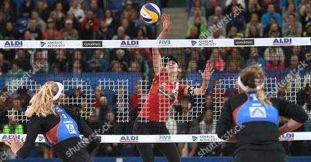 Canada's Melissa Humana-Paredes (C) in action against USA's Alix Klineman (C) and April Ross during the Beach Volleyball World Championships match in Hamburg, Germany, 06 July 2019.