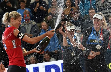 Canada's Sarah Pavan (L) with champagne shower to USA's Alix Klineman (C) and April Ross during the Beach Volleyball World Championships match in Hamburg, Germany, 06 July 2019.