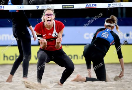 Canada's Sarah Pavan against USA's Alix Klineman and April Ross during the Beach Volleyball World Championships match in Hamburg, Germany, 06 July 2019.