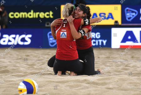 Canada's Melissa Sarah Pavan and Humana-Paredes  (L-R) after the match against USA's Alix Klineman (C) and April Ross during the Beach Volleyball World Championships match in Hamburg, Germany, 06 July 2019.