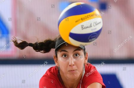 Canada's Melissa Humana-Paredes  in action against USA's Alix Klineman and April Ross during the Beach Volleyball World Championships match in Hamburg, Germany, 06 July 2019.