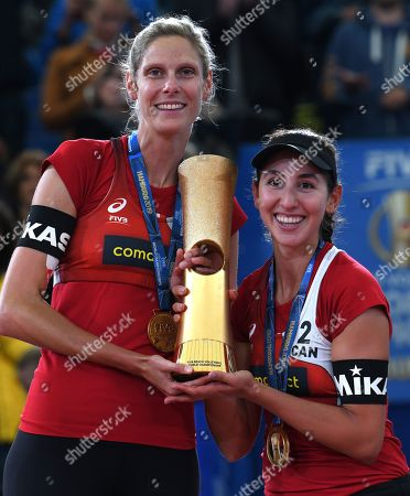 Canada's Sarah Pavan and Melissa Humana-Paredes (L-R) after winning the Gold Medal against USA's Alix Klineman and April Ross during the Beach Volleyball World Championships match in Hamburg, Germany, 06 July 2019.