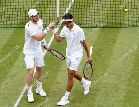 Andy Murray (L) of Britain and Pierre-Hugues Herbert of France in action during their Men's Doubles match against Nikola Mektic of Croatia and Franko Skugor of Croatia at the Wimbledon Championships at the All England Lawn Tennis Club, in London, Britain, 06 July 2019.