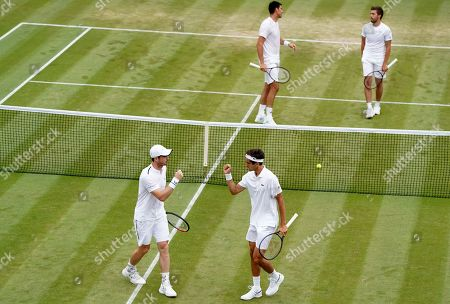 Andy Murray (front L) of Britain and Pierre-Hugues Herbert of France in action during their Men's Doubles match against Nikola Mektic of Croatia and Franko Skugor of Croatia at the Wimbledon Championships at the All England Lawn Tennis Club, in London, Britain, 06 July 2019.