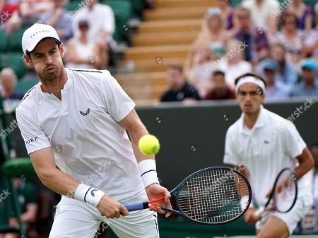 Stock Picture of Andy Murray (L) of Britain and Pierre-Hugues Herbert of France in action during their Men's Doubles match against Nikola Mektic of Croatia and Franko Skugor of Croatia at the Wimbledon Championships at the All England Lawn Tennis Club, in London, Britain, 06 July 2019.