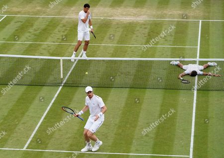 Andy Murray (front) of Britain in action during the Men's Doubles match with Pierre-Hugues Herbert of France against Nikola Mektic of Croatia and Franko Skugor of Croatia at the Wimbledon Championships at the All England Lawn Tennis Club, in London, Britain, 06 July 2019.