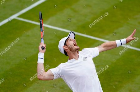 Stock Photo of Andy Murray of Britain in action during the Men's Doubles match with Pierre-Hugues Herbert of France against Nikola Mektic of Croatia and Franko Skugor of Croatia at the Wimbledon Championships at the All England Lawn Tennis Club, in London, Britain, 06 July 2019.