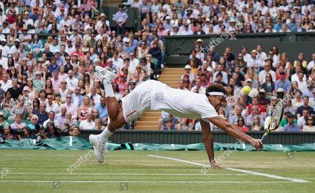 Jo-Wilfred Tsonga (FRA) dives to save the point against Rafael Nadal (ESP)