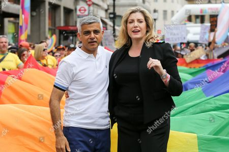 Mayor of London Sadiq Khan (L) and Penny Mordaunt Minister for Women and Equalities (R) at the start of the annual Pride Parade in central London
