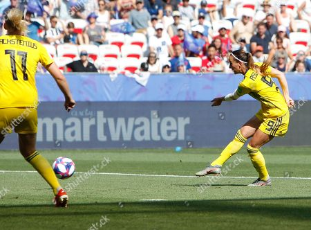 Sweden's Kosovare Asllani, right, scores her side's opening goal during the Women's World Cup third place soccer match between England and Sweden at Stade de Nice, in Nice, France