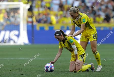 Sweden's Kosovare Asllani, left, and Sweden's Magdalena Eriksson react during the Women's World Cup third place soccer match between England and Sweden at Stade de Nice, in Nice, France