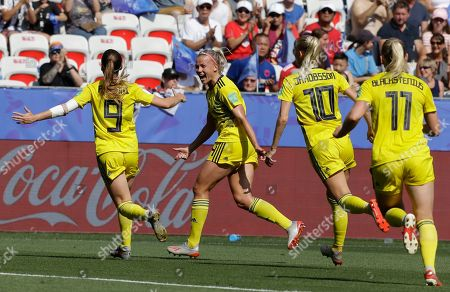 Sweden's Kosovare Asllani, left, celebrates after scoring her side's opening goal during the Women's World Cup third place soccer match between England and Sweden at Stade de Nice, in Nice, France