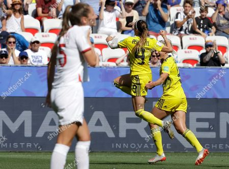 Sweden's Kosovare Asllani, center, celebrates after scoring her side's opening goal during the Women's World Cup third place soccer match between England and Sweden at Stade de Nice, in Nice, France