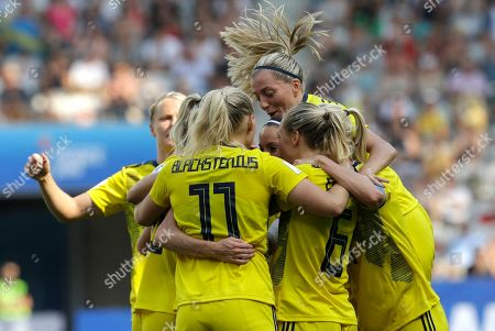 Sweden players celebrate after Sweden's Kosovare Asllani scored her side's opening goal during the Women's World Cup third place soccer match between England and Sweden at Stade de Nice, in Nice, France