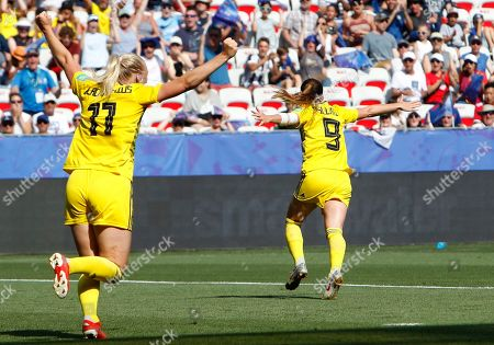 Sweden's Kosovare Asllani, right, celebrates after scoring her side's opening goal during the Women's World Cup third place soccer match between England and Sweden at Stade de Nice, in Nice, France