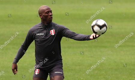 Peru's Luis Advincula holds a ball during a training session in Rio de Janeiro, Brazil, . Peru will face Brazil for the Copa America final soccer match on July, 7