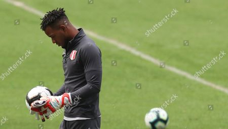Peru's goalkeeper Pedro Gallese holds a ball during a training session in Rio de Janeiro, Brazil, . Peru will face Brazil for the Copa America final soccer match on July, 7