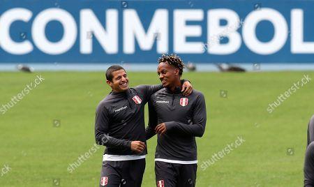 Peru's Andre Carrillo, right, and Aldo Corzo attend a training session in Rio de Janeiro, Brazil, . Peru will face Brazil for the Copa America final soccer match on July, 7
