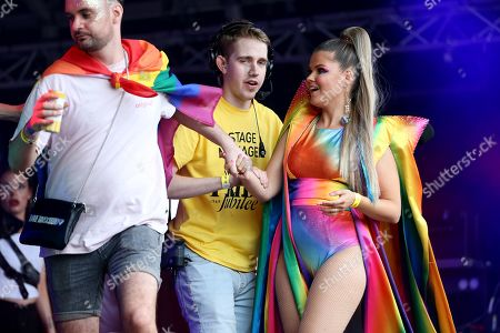 Finnish singer Saara Aalto (R) is pulled off stage after her performance was interrupted because people were getting into the fountains at Trafalgar Square during London Pride, the Lesbian, Gay, Bisexual, and Transgender (LGBT) parade in London, Britain, 06 July 2019. According to reports, about 30 thousand people are about to take part in the annual event aiming to raise awareness and campaign for equality on LGBT issues.