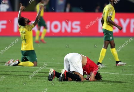 Stock Image of Amr Warda (C) of Egypt reacts after the 2019 Africa Cup of Nations (AFCON 2019) round of 16 soccer match between Egypt and South Africa in Cairo Stadium, Cairo, Egypt, 06 July 2019.