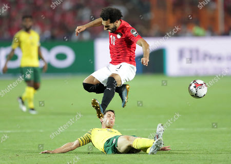 Egypt's Mohamed Salah (top) in action against South Africa's Dean Furman during the 2019 Africa Cup of Nations (AFCON 2019) round of 16 soccer match between Egypt and South Africa in Cairo Stadium, Cairo, Egypt, 06 July 2019.