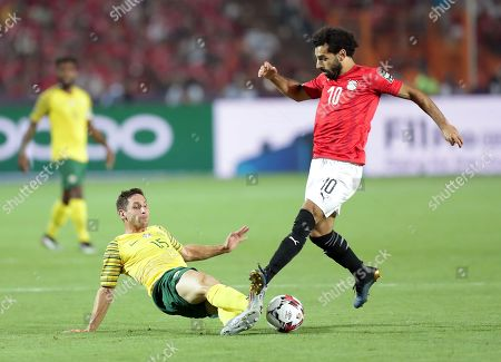 Egypt's Mohamed Salah (R) in action against South Africa's Dean Furman during the 2019 Africa Cup of Nations (AFCON 2019) round of 16 soccer match between Egypt and South Africa in Cairo Stadium, Cairo, Egypt, 06 July 2019.