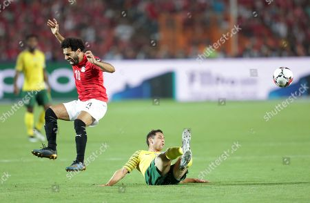 Egypt's Mohamed Salah (L) in action against South Africa's Dean Furman during the 2019 Africa Cup of Nations (AFCON 2019) round of 16 soccer match between Egypt and South Africa in Cairo Stadium, Cairo, Egypt, 06 July 2019.