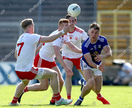 Stock Image of Cavan vs Tyrone. Cavan's Conor Madden is tackled by Frank Burns and Hugh Pat McGleary of Tyrone
