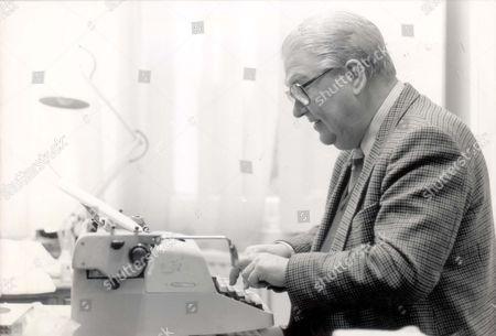 Kingsley Amis. Leading Author Sir Kingsley Amis At Work At His Typewriter.