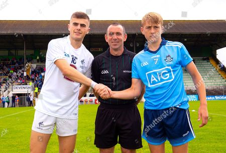 Dublin vs Kildare. Kildare's Aaron Browne and Jack Lundy of Dublin with referee David Hickey