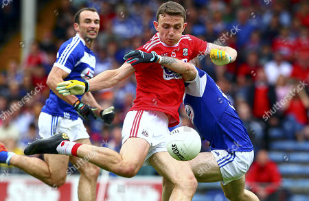 Cork vs Laois. Cork's Mark Collins shoots to score his sides second goal under pressure from Trevor Collins of Laois