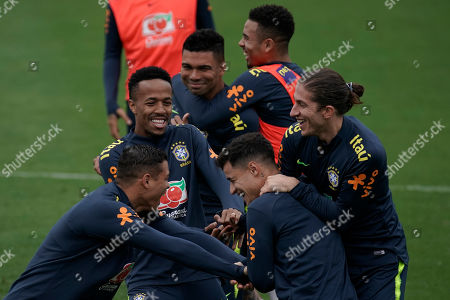 Brazil soccer players Thiago Silva, left, Eder Miltao, second left, Philippe Coutinho, center and Filipe Luis joke around as they take part in a practice session at the Granja Comary training center in Teresopolis, Brazil, . Brazil will face Peru for the Copa America final soccer match on July 7