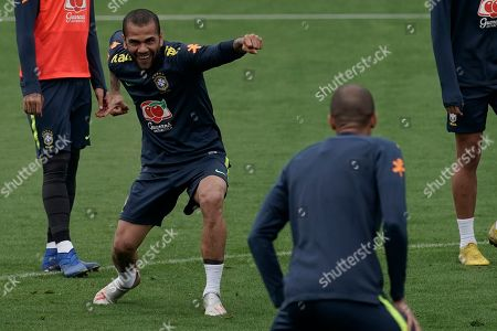 Brazil's Daniel Alves jokes around as he takes part in a practice session at the Granja Comary training center in Teresopolis, Brazil, . Brazil will face Peru for the Copa America final soccer match on July 7
