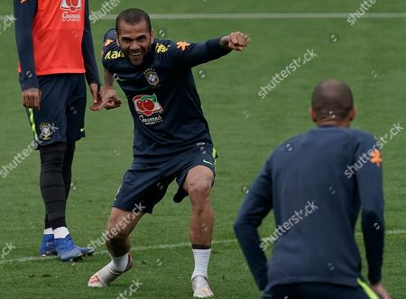 Brazil's Daniel Alves jokes during a practice session at the Granja Comary training center in Teresopolis, Brazil, . Brazil will face Peru for the Copa America final soccer match on July 7