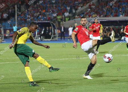 South Africa's Thembinkosi Lorch shoots by Egypt's Abdallah Said during the African Cup of Nations round of 16 soccer match between Egypt and South Africa in Cairo International stadium in Cairo, Egypt