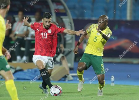 Egypt's Abdallah Said, left, and South Africa's Thamsanqa Mkhize fight for the ball during the African Cup of Nations round of 16 soccer match between Egypt and South Africa in Cairo International stadium in Cairo, Egypt